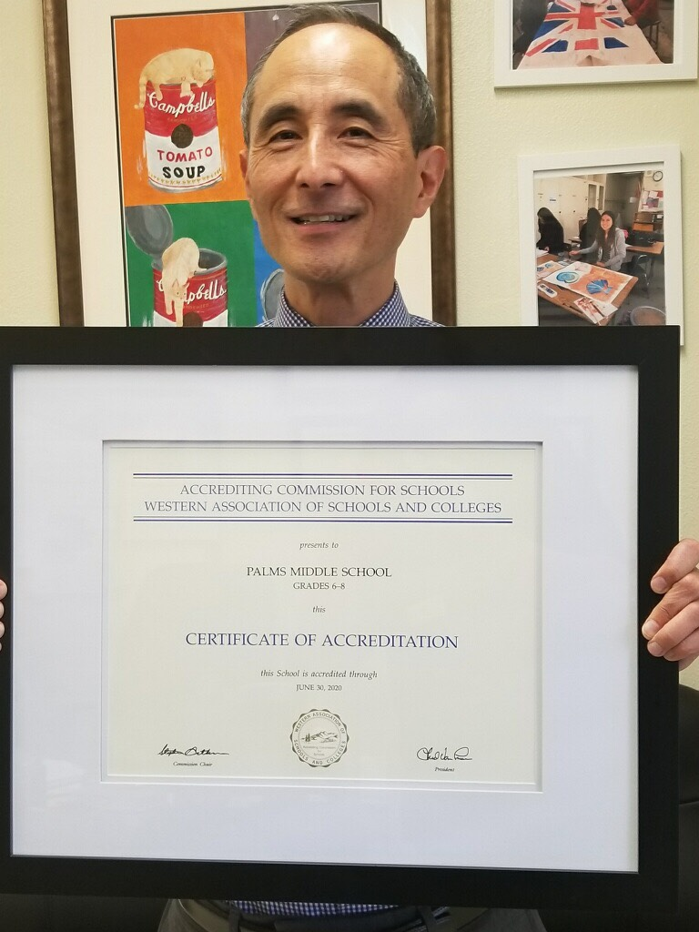 Dr. Moruchi holding Certificate or Accreditation