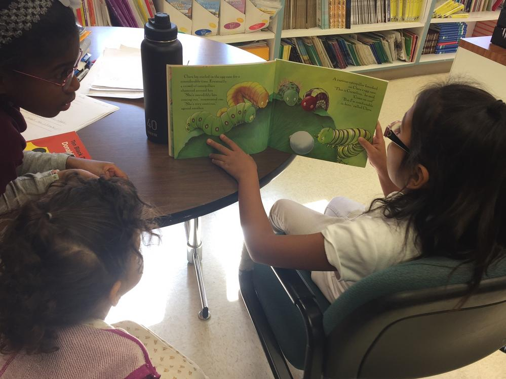 Grade 3 reads with the Pre K students.