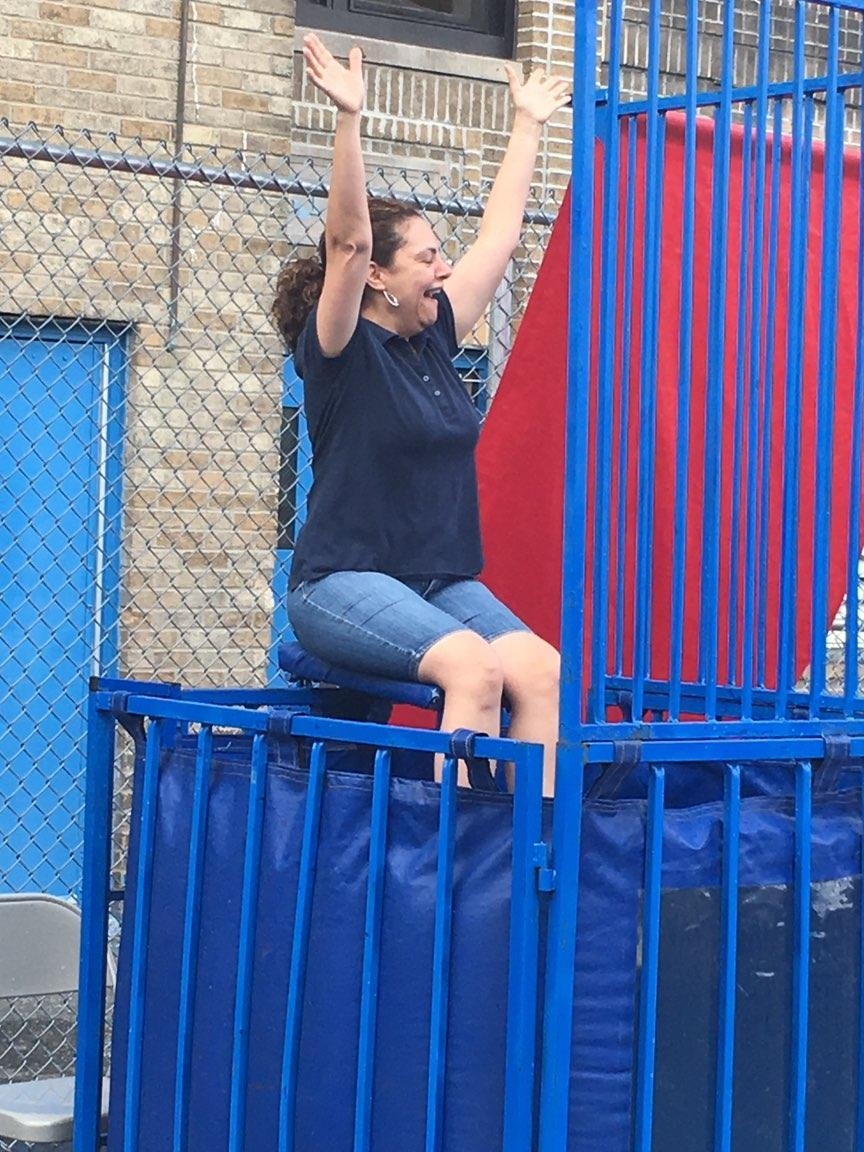 Mrs. Irizarry going into the dunk tank