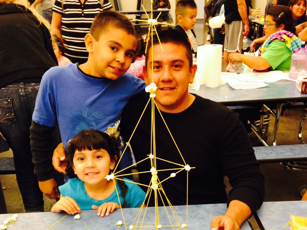 Mr.Gonzales, Victoriano and younger sister enjoying science projects!