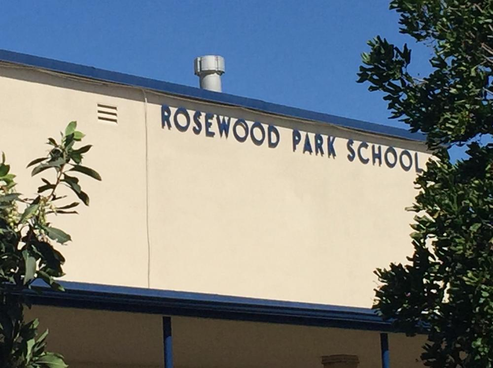 PIcture of the front of the school sign
