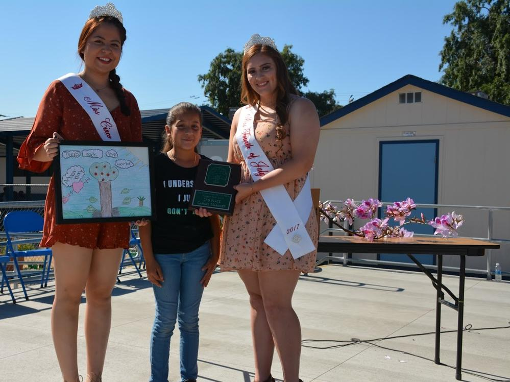 city of commerce princesses with winning Arbor Day Poster Contest Student