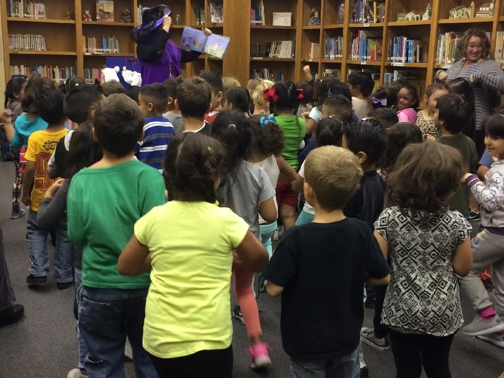Mrs.Xavier read and sang her spooky Halloween books.