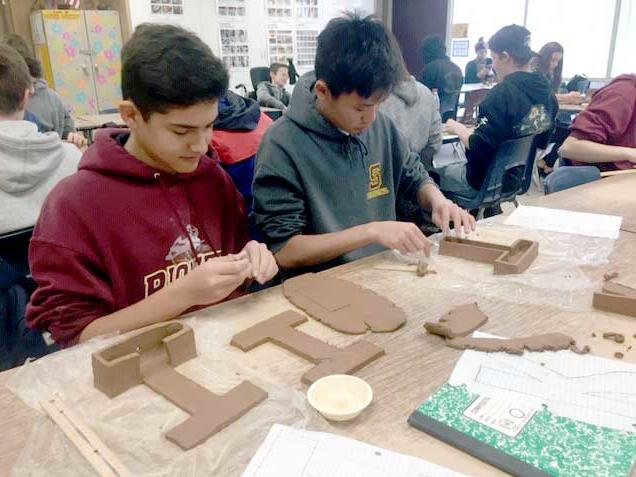 Ian Williams and Justin Tuong creating a ceramics project