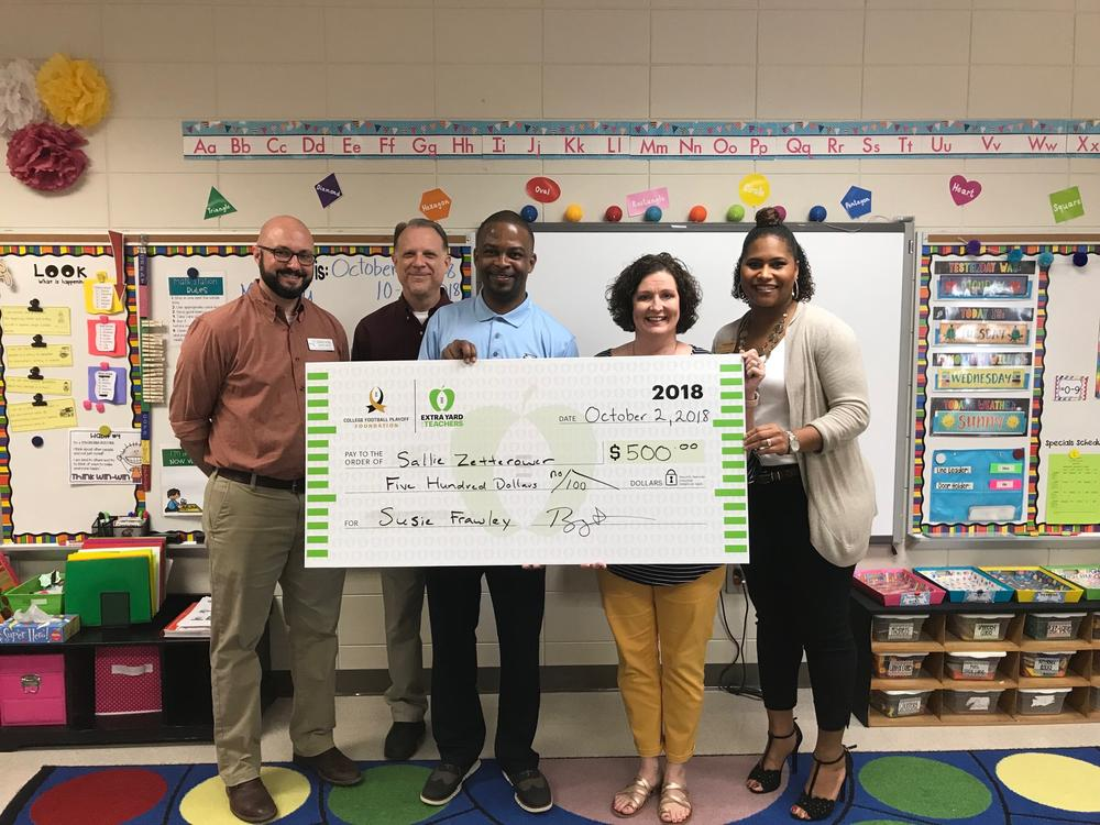 Georgia Southern presenting a teacher with a grant