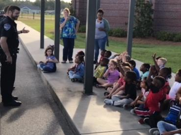 Kindergarten listening to the Police Officers.