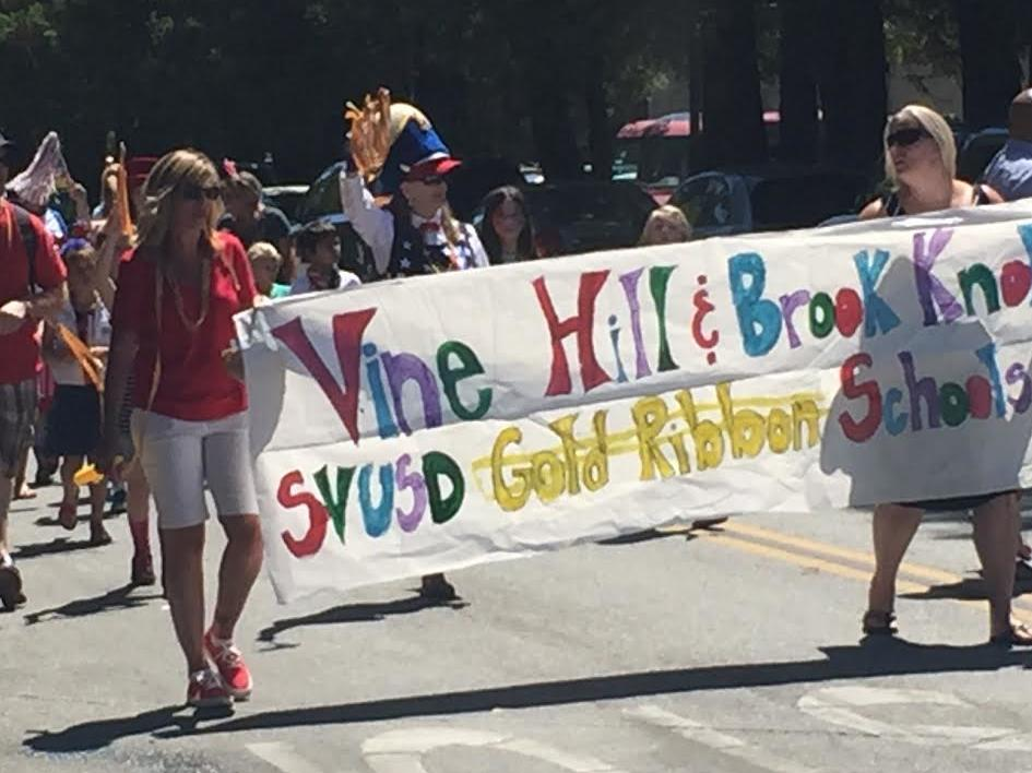 Michelle Stewart and Chris Breeden lead Vine Hillin the July 4th parade