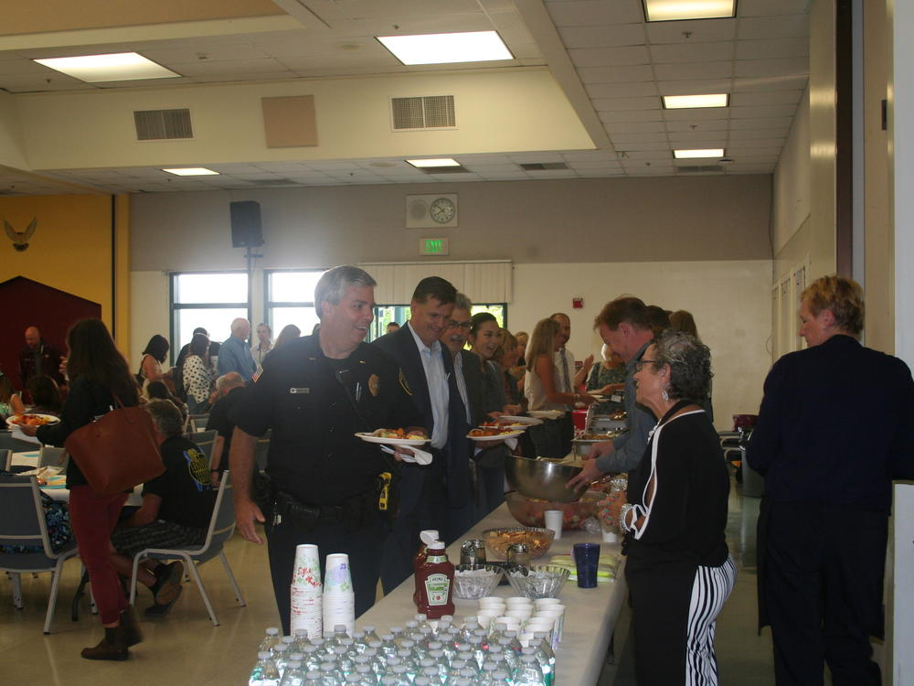 Administrators and Community Members welcoming and serving breakfast to all