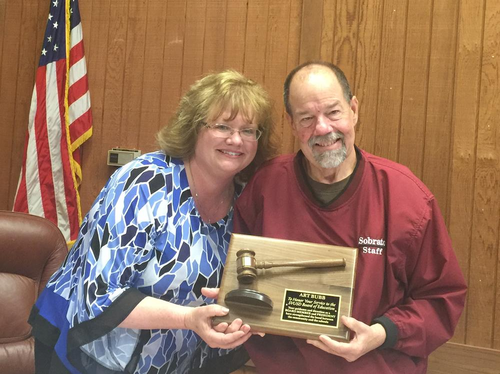 Outgoing Superintendent, Penny Weaver honoring Art Bubb for his years of  service on the SVUSD Board