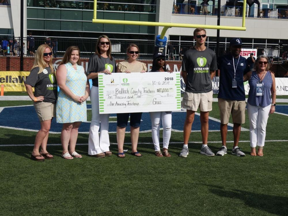 Mrs. Beasley receiving her grant check at GSU game!