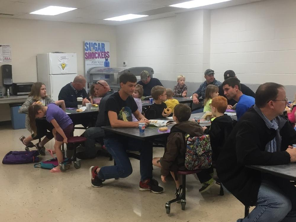 On Thursday, April 13, dads were invited to the school to share donuts with  their children.