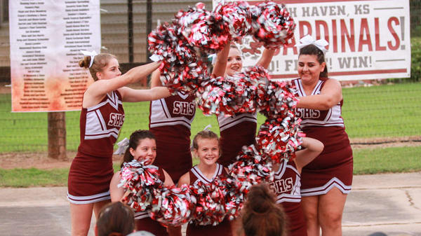 Cheerleaders use their pompoms to make the S for the SHS cheer.