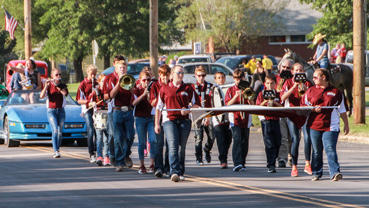 Members of the band march down the street