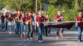 Members played the fight song as they marched down the street.