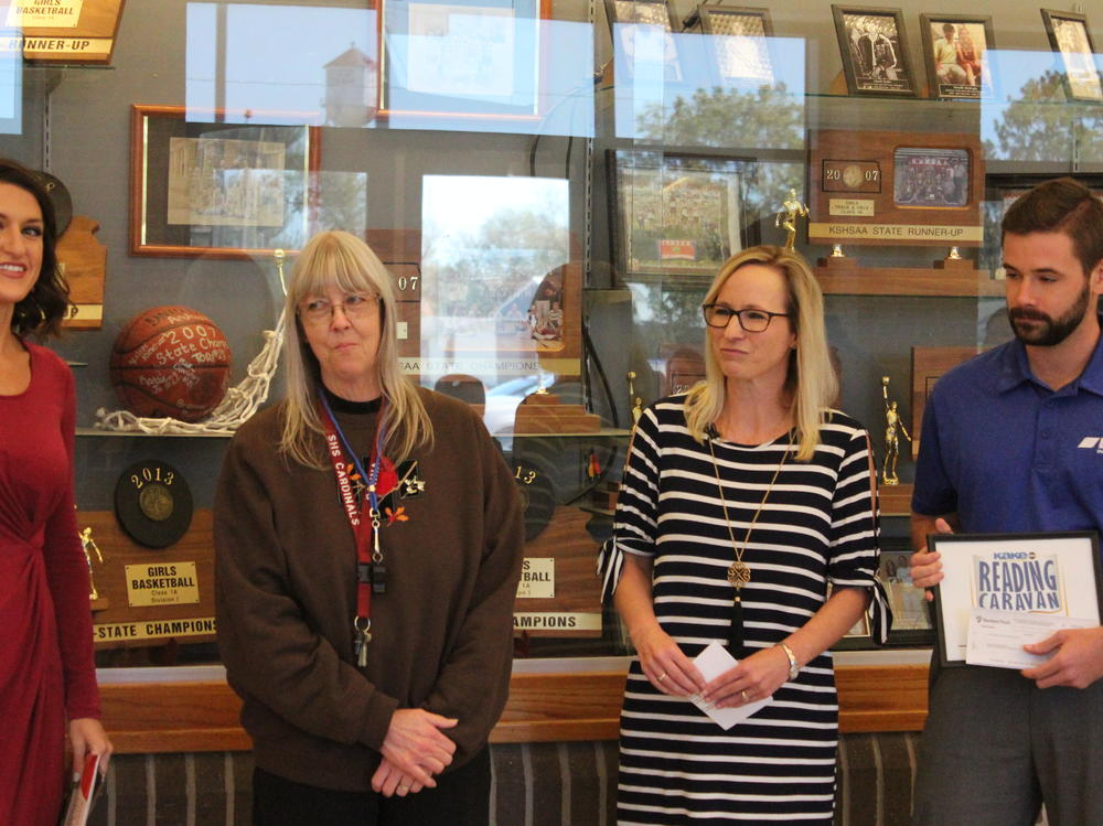 Mrs. Mathews was surprised by KAKE News Anchor Alyson Acklin and EMC Insurance  representatives Tuesday morning, October 17.