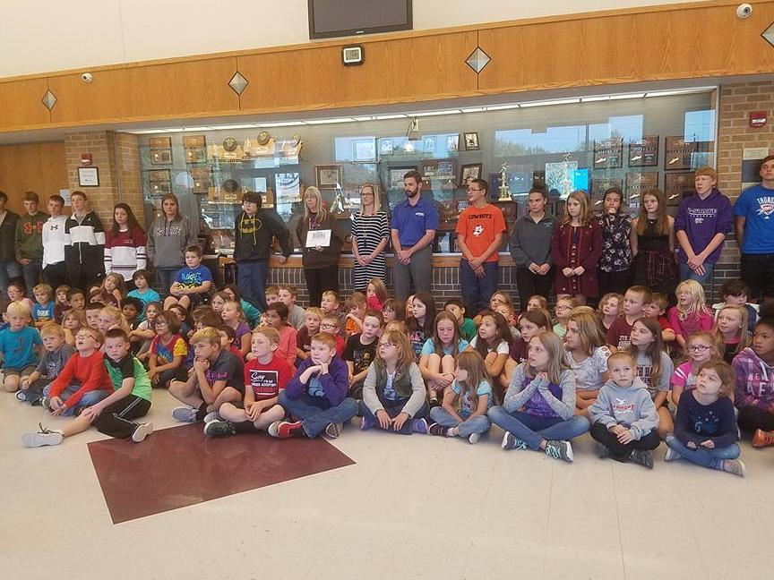 EMC Insurance presented Mrs. Mathews with a 1000 grant to be used for the  school library. This is a part of KAKE and EMC s Reading Caravan.