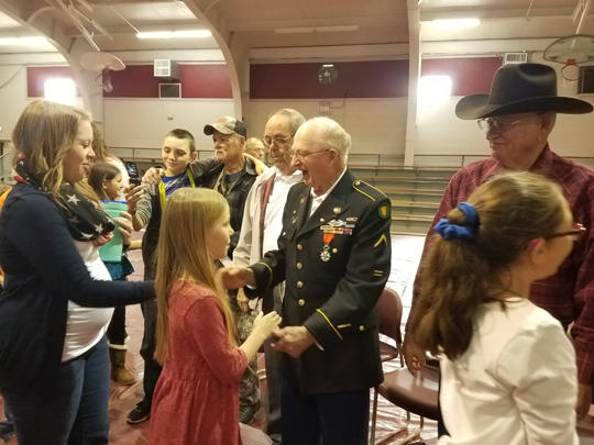 When the program ended, students lined up to shake the veterans hands and thank  them for their service.
