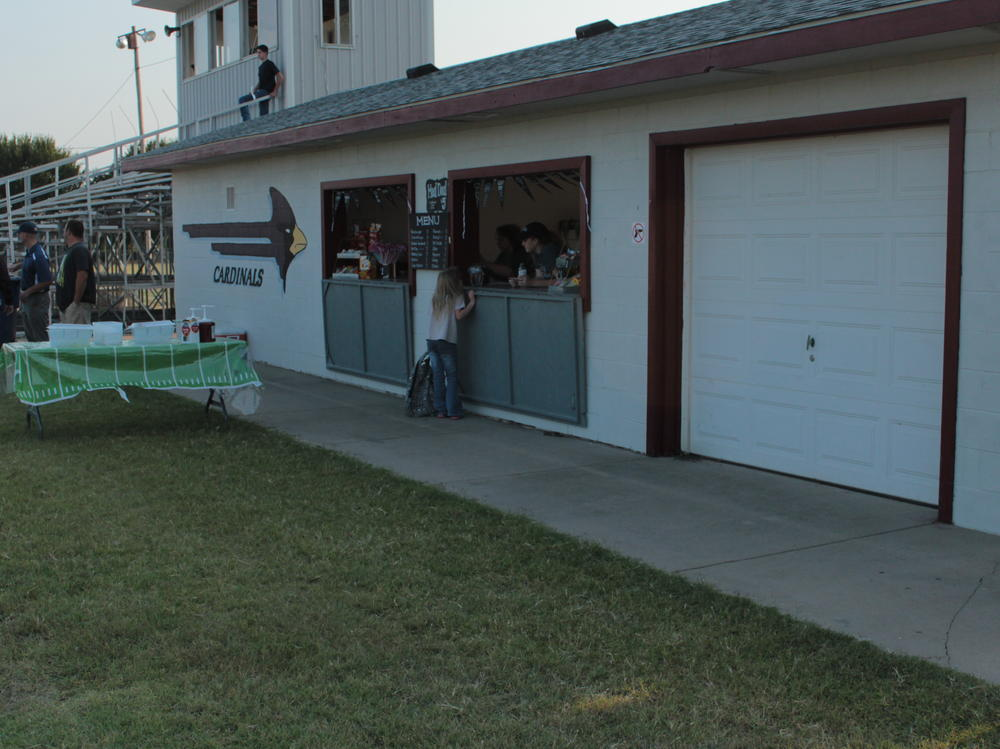 The seniors man the concession stand for home football games.