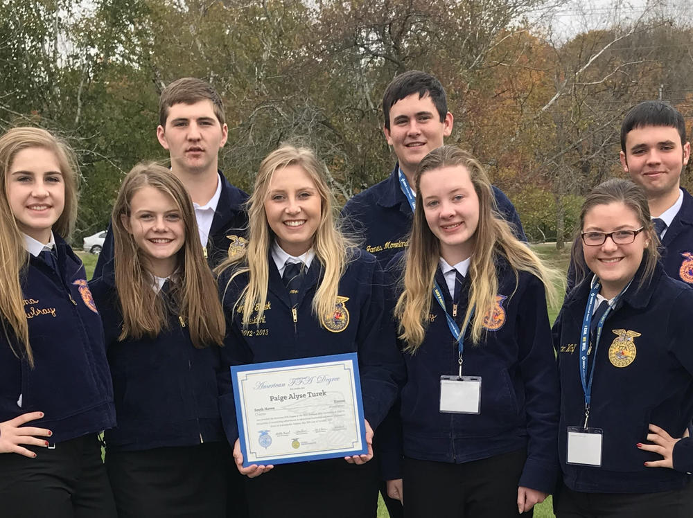 FFA Members who attended the 2017 National FFA Convention pose with Paige  Turek, 2016 SHS graduate, who received her American FFA Degree at the  Convention.