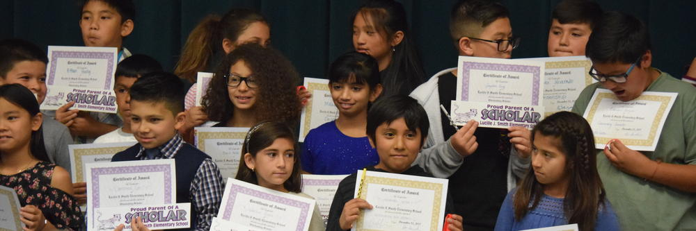 Students with their Trimester Awards