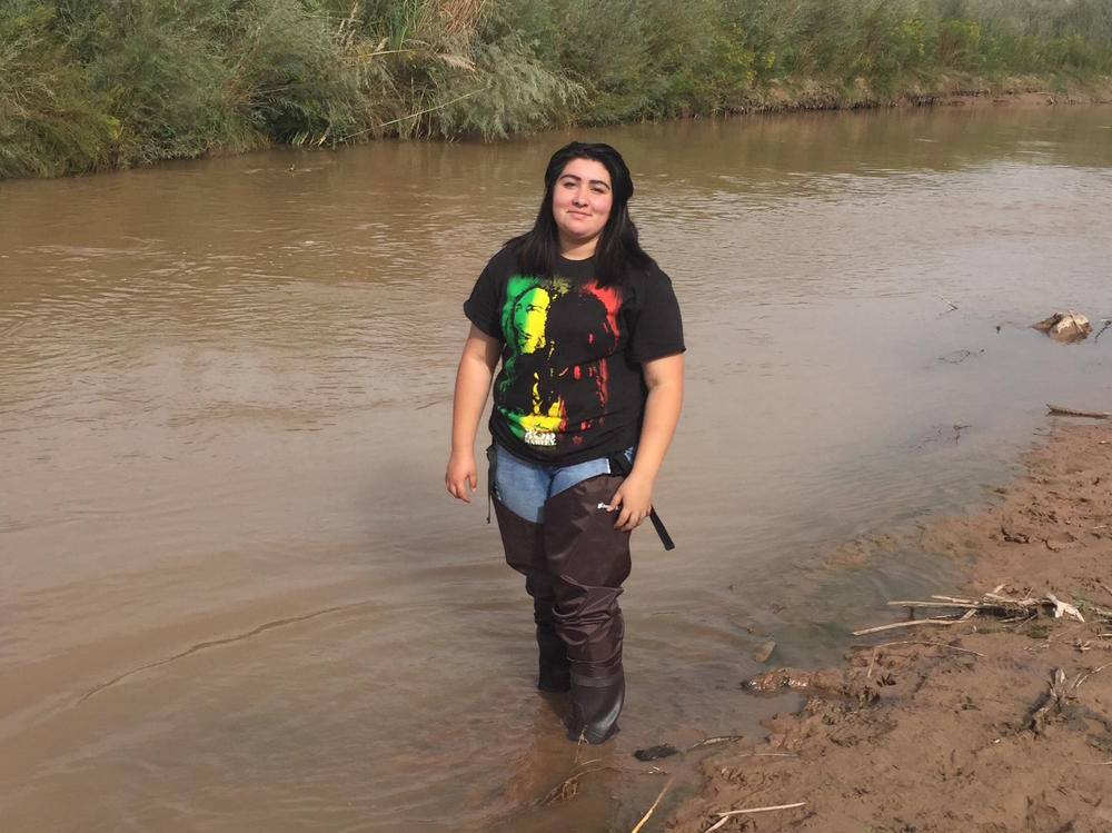 Student in River on a BEMP Fieldtrip