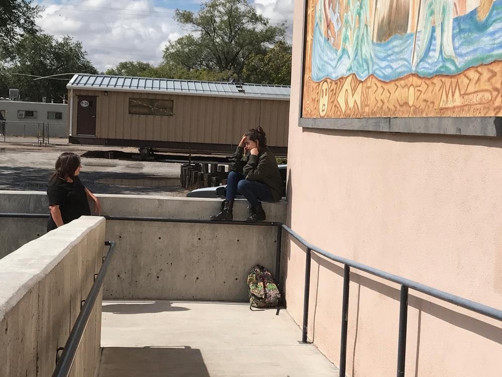 Student and teachers standing outside at lunch