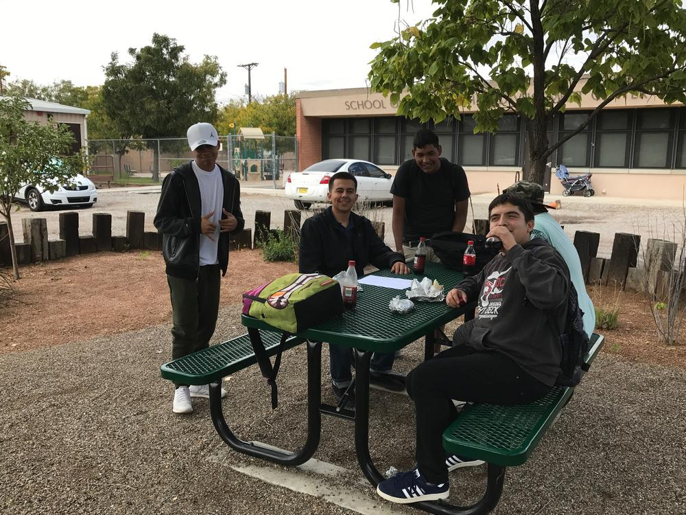 Students and principal outside at lunch