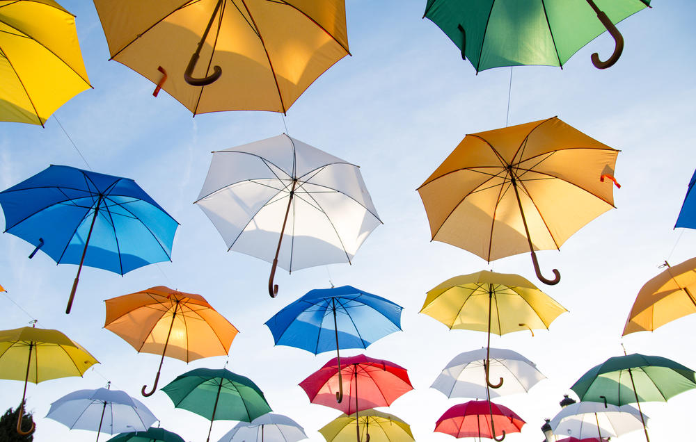 Colorful umbrellas in sky 3d art