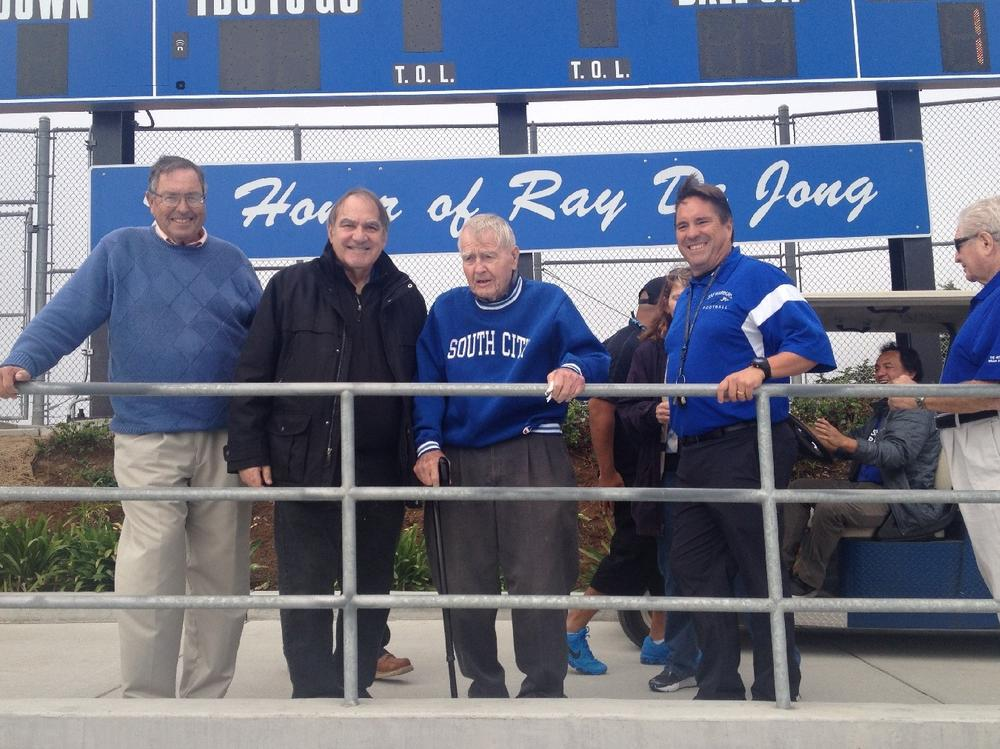 Former teachers and coaches Gene Mullin and Jim Orlich attend honor for Ray De  Jong Field rededication. Frank Moro right current Athletic Director and alumni.