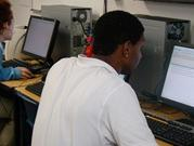 TLC student completing coursework via E-2020