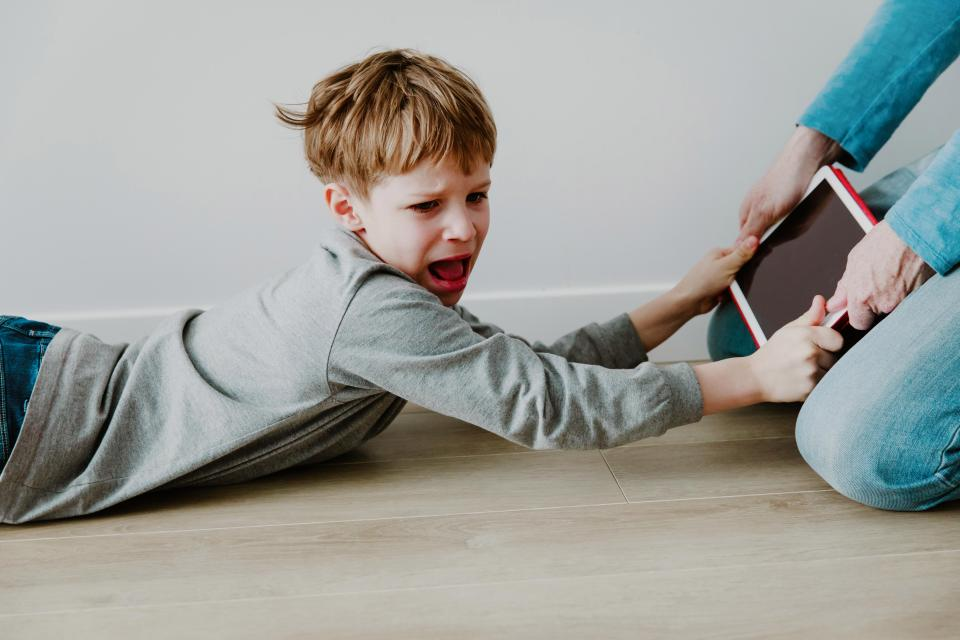 child dragged with ipad