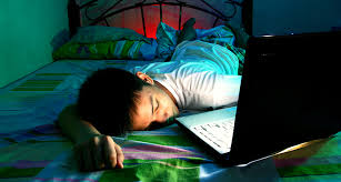 boy asleep by laptop computer