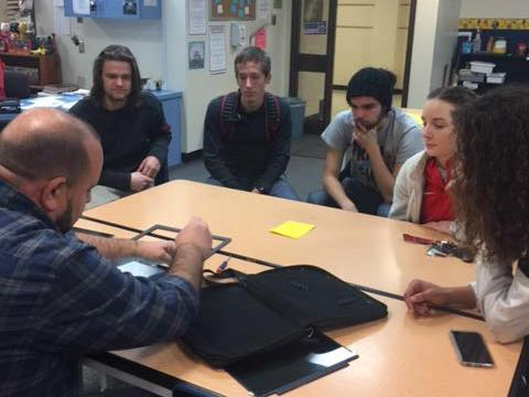UHS WITS students learning Chromebook repairs