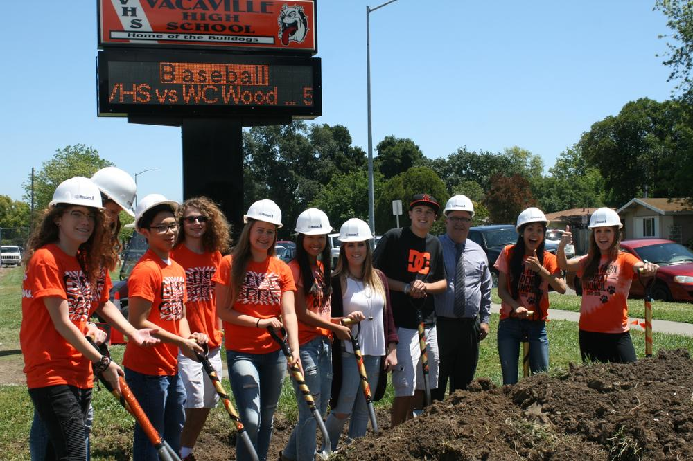 Students lined up with shovels for groundbreaking