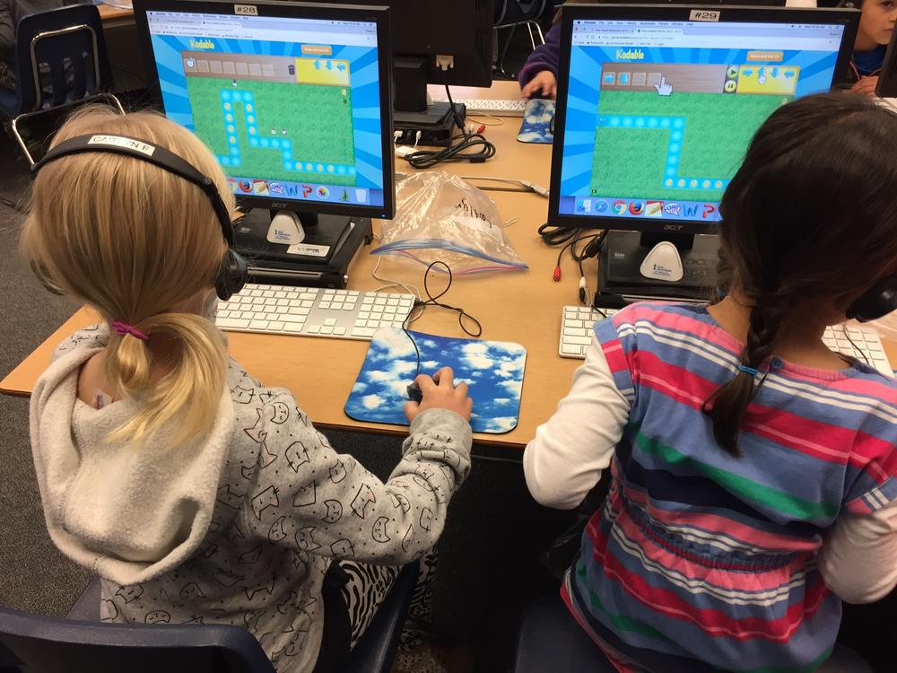 Kids practicing coding skills!