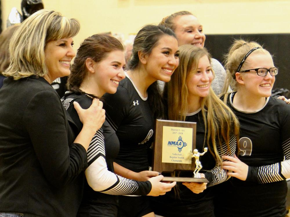 Volleyball with 1A 6A district trophy