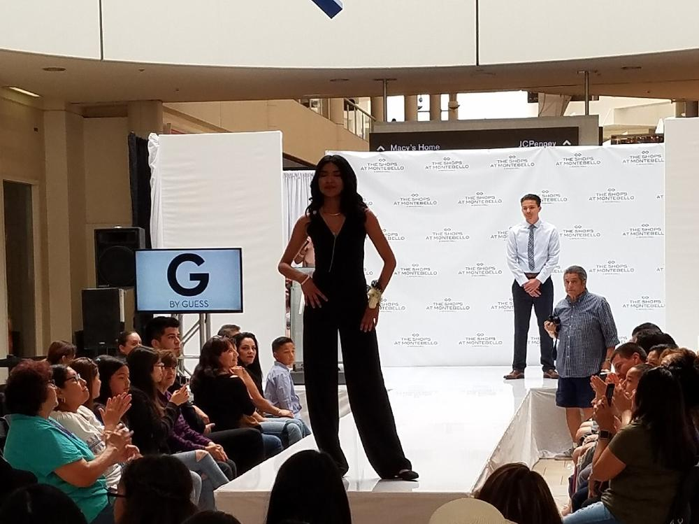 photo of student on the runway for fashion show