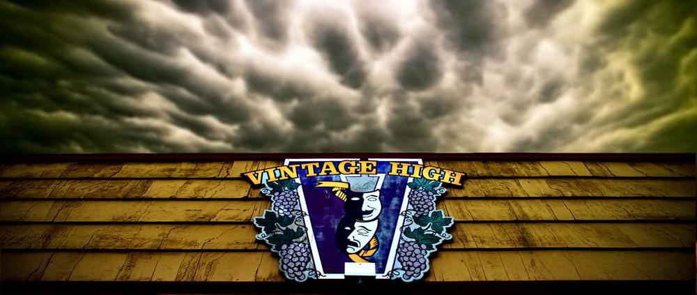 Vintage High School Drama logo under dramatic dark clouds