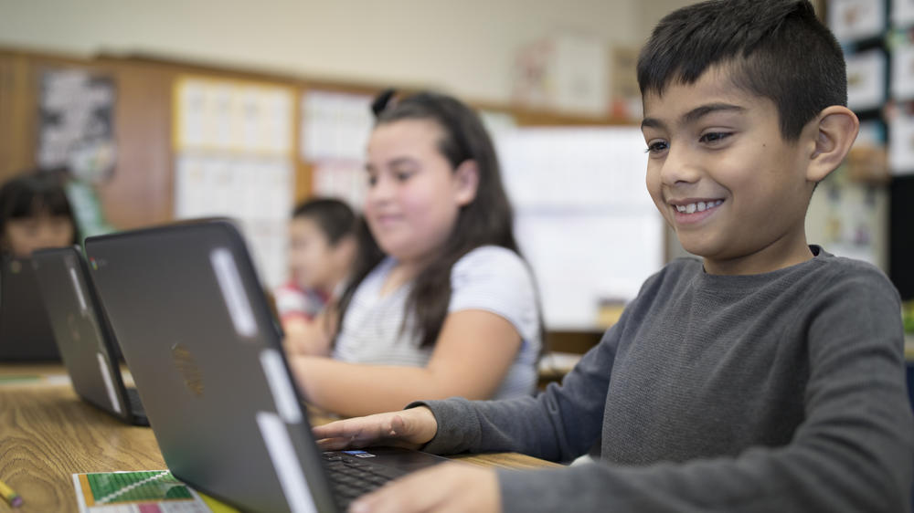 Student enjoys using his chromebook in class