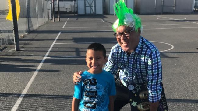 Mr.Koga wears a green Mohawk! Celebrating Attendance Challenge Day with Green  Student!
