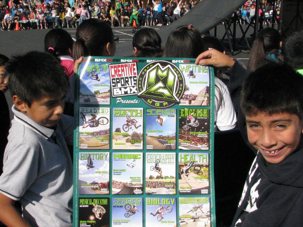 Two students holding BMX poster