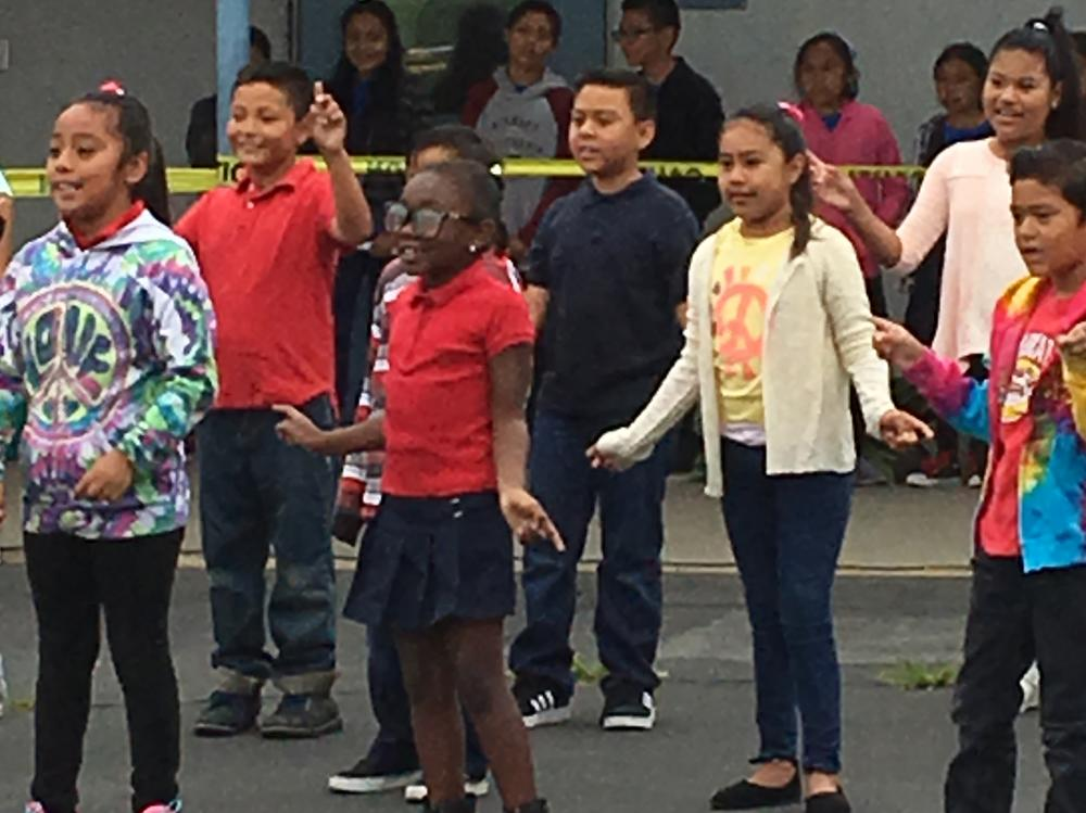 A second grade class performing a dance at the Wildcat Rally.