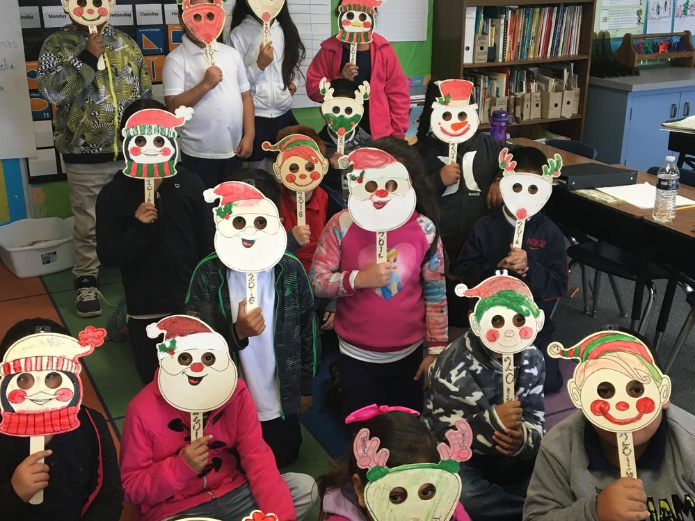 These students made Santa and reindeer masks for the holidays.