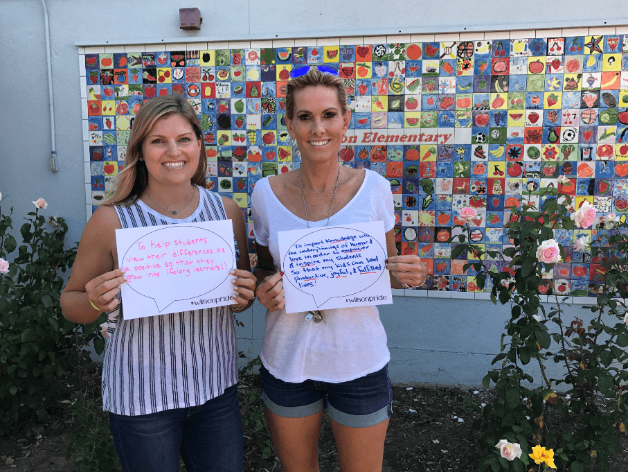 SAI teachers showing their Why statements with wilson pride