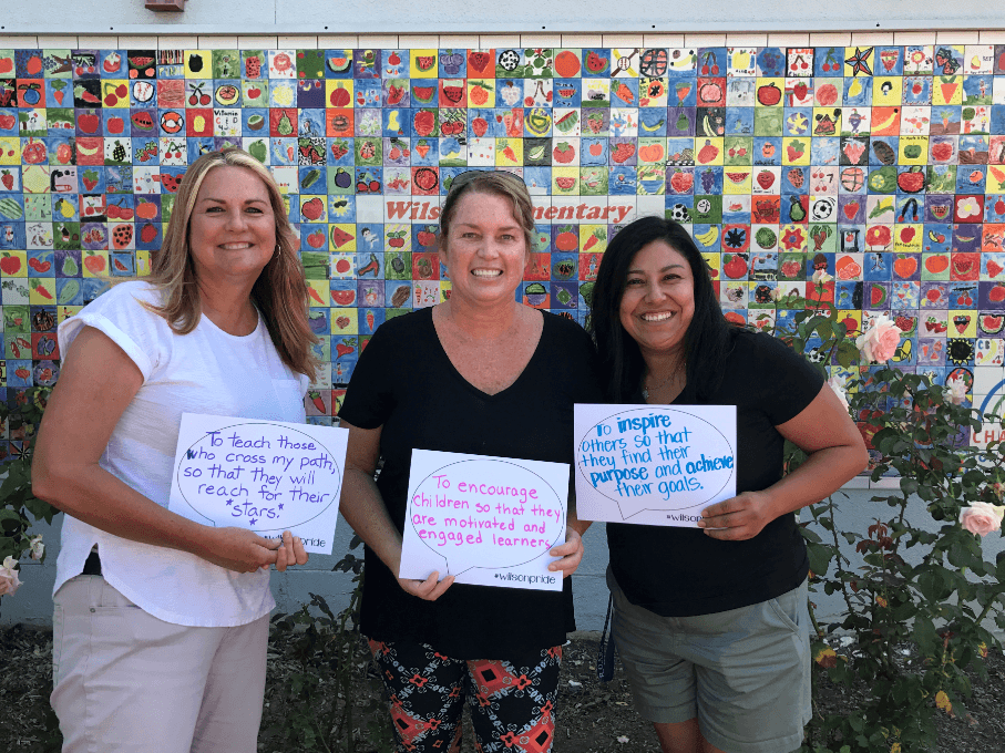 First grade teachers showing their Why statements with wilson pride