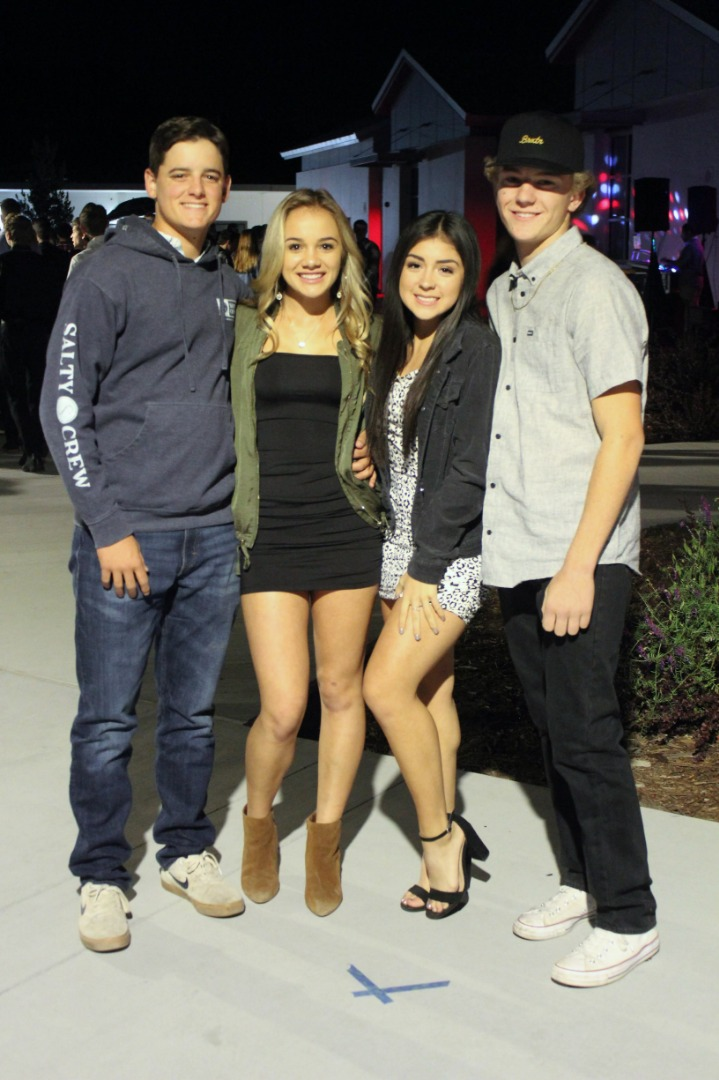 Four students at the homecoming dance