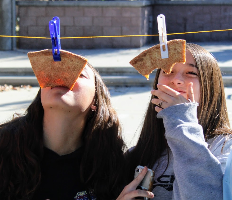 Girls competing in pizza eating contest
