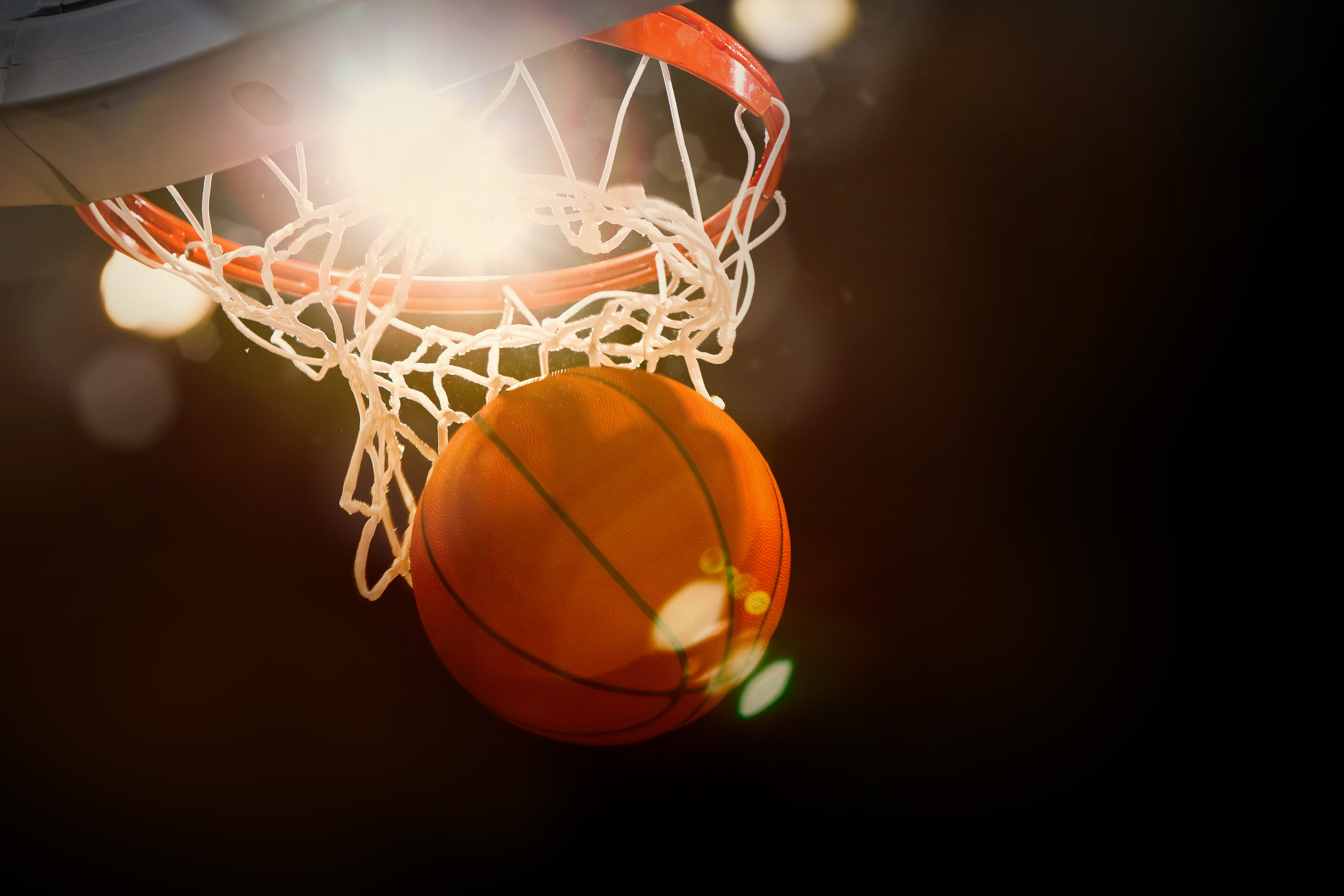bigstock-Basketball-going-through-the-b-64218517.jpg