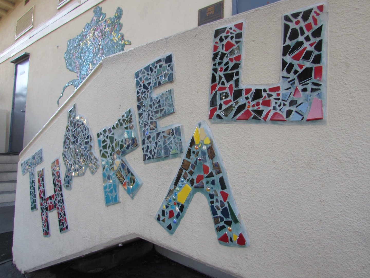 A picture of a mosaic lettering spelling