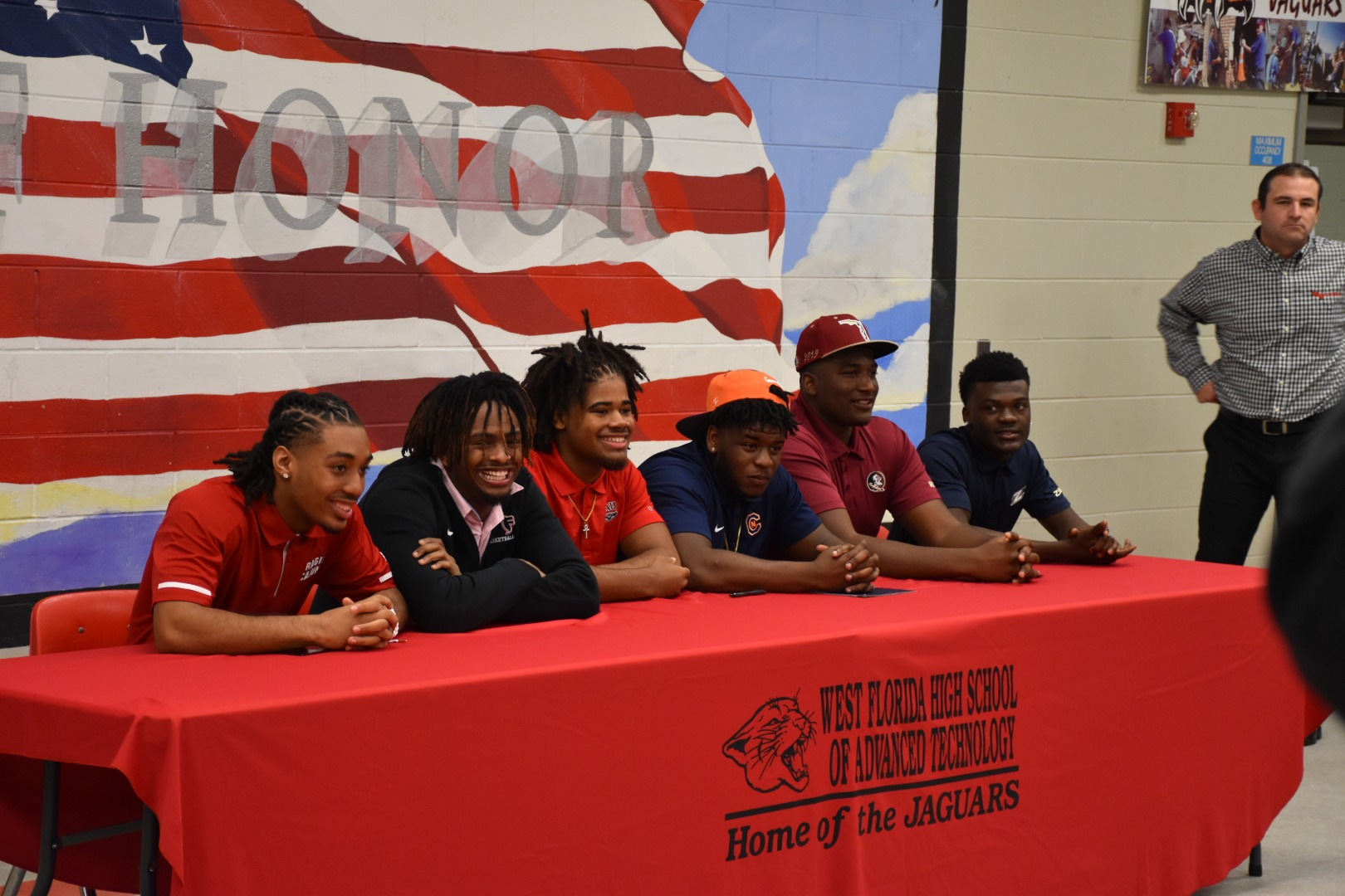 football signing day: photographer Mikquis James